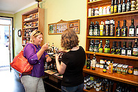 Shoppers at Olive and Vine in St. John's neighborhood, Portland Oregon. Olive and Vine offers gourmet salt, oil, vinegar, tea and spice