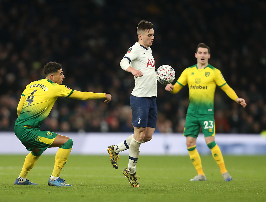 Tottenham Hotspur's Giovani Lo Celso gets in between Norwich City's Ben Godfrey and Kenny McLean<br /> <br /> Photographer Rob Newell/CameraSport<br /> <br /> The Emirates FA Cup Fifth Round - Tottenham Hotspur v Norwich City - Wednesday 4th March 2020 - Tottenham Hotspur Stadium - London<br />  <br /> World Copyright © 2020 CameraSport. All rights reserved. 43 Linden Ave. Countesthorpe. Leicester. England. LE8 5PG - Tel: +44 (0) 116 277 4147 - admin@camerasport.com - www.camerasport.com