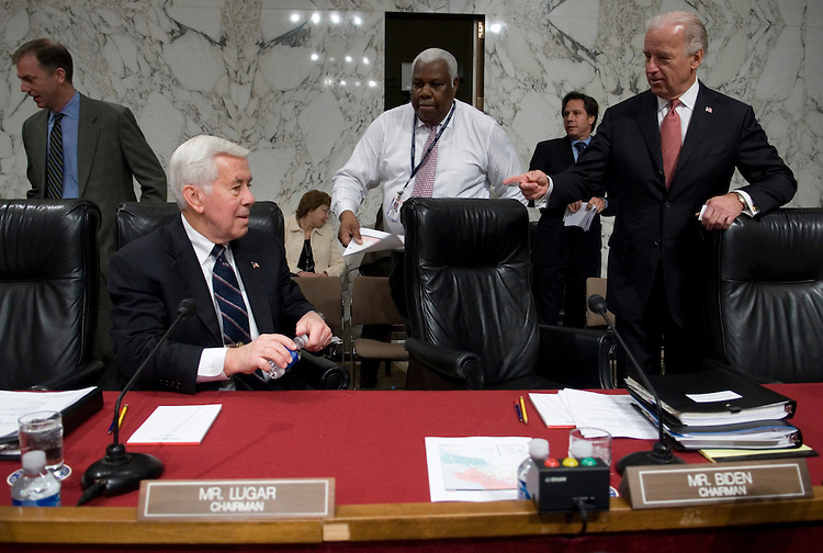 Outgoing chairman Richard Lugar, R-Ind., and incoming chairman Joe Biden, D-Del., take their seats for the Senate Foreign Relations Committee hearing on Iraq in the Hart building on Wednesday, Jan. 10, 2007.