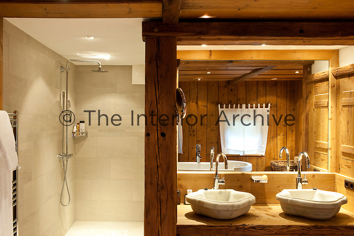 The wood-panelled bathroom also benefits from a contemporary walk-in shower