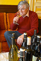 Bernard Jany Chateau la Condamine Bertrand. Pezenas region. Languedoc. Owner winemaker. Tasting wine. France. Europe. Bottle. Wine glass.