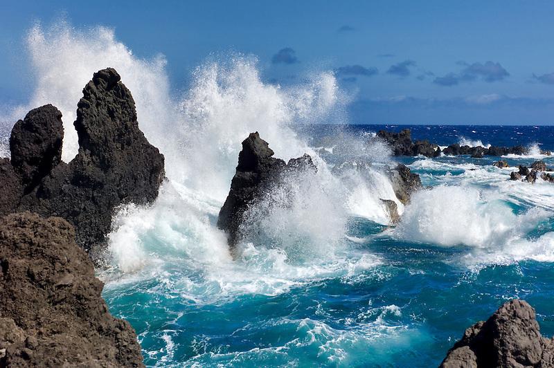 Waves crashing on volcanic rocks. Laupahoehoe Point Beach Park. Hawaii, the big Island.