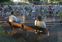 15 JUN 2003 - WINDSOR, UK - Supporters watch competitors prepare in transition at the 2003 Windsor Triathlon. (PHOTO (C) NIGEL FARROW)