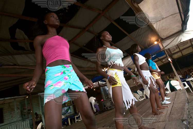 Girls as young as sixteen entertain the audience at a beach club in Lagos. They are often picked up by men after the show.