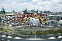 Peloton riding through the Port of Antwerp.<br /> <br /> Antwerp Port Epic 2018 (formerly &quot;Schaal Sels&quot;)<br /> One Day Race: Antwerp &gt; Antwerp (207km of which 32km are cobbles &amp; 30km is gravel/off-road!)