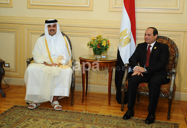 Egypt's President Abdel Fattah al-Sisi (R) sits with Qatar Sheikh Tamim bin Hamad al Thani upon his arrival ahead of the Arab Summit in Sharm el-Sheikh, in the South Sinai governorate, south of Cairo, March 28, 2015. Arab League heads of state will hold a two-day summit to discuss a range of conflicts in the region, including Yemen and Libya, as well as the threat posed by Islamic State militants. Egyptian Presidency