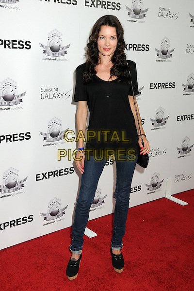 "GINA HOLDEN.Matt Leinart's 4th Annual ""Bowling With The Stars"" Event held at Lucky Strike Lanes, Hollywood, California, USA..July 15th, 2010.full length jeans denim black top.CAP/ADM/BP.©Byron Purvis/AdMedia/Capital Pictures."