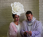 LOUISVILLE, KY - MAY 05: A man and woman hide from the rain and read a program on Kentucky Derby Day at Churchill Downs on May 5, 2018 in Louisville, Kentucky. (Photo by Scott Serio/Eclipse Sportswire/Getty Images)
