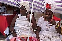 Santeria women posing for tourists, La Habana Vieja