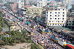 Pictured: Muslims pray in the streets of Tongi, Bangladesh as part of Bishwa Ijteman.<br /> <br /> Millions of praying Muslims stopped traffic today as they took part in an annual religious festival.  They prayed together for ten minutes as traffic came to a standstill in the town of Tongi, Bangladesh.<br /> <br /> The worshippers all faced in one direction, towards Mecca - the holiest of Muslim cities.  SEE OUR COPY FOR DETAILS.<br /> <br /> Please byline: Syed Mahabubul Kader/Solent News<br /> <br /> © Syed Mahabubul Kader/Solent News & Photo Agency<br /> UK +44 (0) 2380 458800