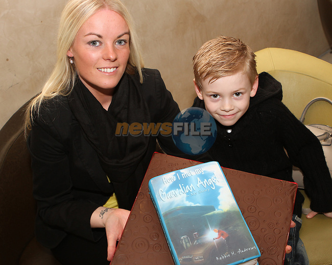 """Cian and Vicki Shannon with the Suprise cake made by """"All Occasion Catering"""" at the Launch of Robbie Andrew's Book in the D Hotel...(Photo credit should read Jenny Matthews/NEWSFILE)..."""