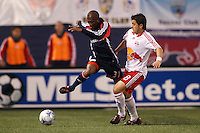New England Revolution midfielder Sainey Nyassi (31) fights through the tackle of New York Red Bulls midfielder Sinisa Ubiparipovic (8). The New York Red Bulls and the New England Revolution played to a 1-1 tie during a Major League Soccer match at Giants Stadium in East Rutherford, NJ, on April 19, 2008.