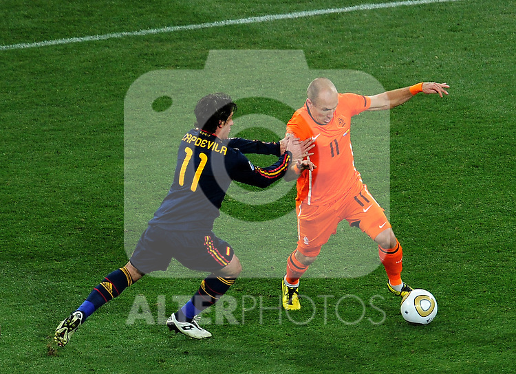 Arjen Robben takes on Capdevila of Spain during the 2010 FIFA World Cup South Africa  Final match between Holland and Spain at Soccer City  on 11 July, 2010 in Johannesburg, South Africa.