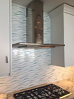 Oasis, a handmade water jet mosaic, is shown in Moonstone and Feldspar jewel glass.<br />