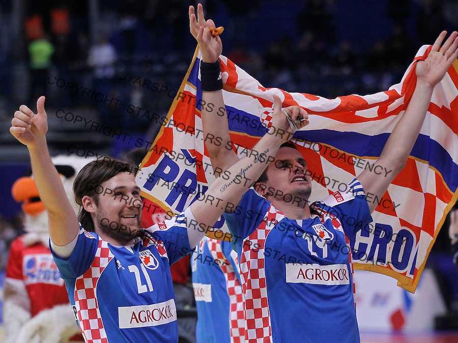 BELGRADE, SERBIA - JANUARY 29: Ivan Cupic (L) and Ivan Nincevic of Croatia celebrates victory against Spain during the Men's European Handball Championship 2012 Bronze medal match between Croatia and Spain at Arena Hall on January 29, 2012 in Belgrade, Serbia.  (Photo by Srdjan Stevanovic/Starsportphoto.com ©)