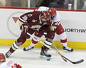 Brian Boyle 10 of Boston College and Andrew Joudrey 24 of the University of Wisconsin fight for puck possession. The Boston College Eagles defeated the University of Wisconsin Badgers 3-0 on Friday, October 27, 2006, at the Kohl Center in Madison, Wisconsin in their first meeting since the 2006 Frozen Four Final which Wisconsin won 2-1 to take the national championship.<br />