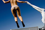 """Sex worker, and 2006 Bunny Ranch Courtesan of the Year, Jenny Lane bounces on a trampoline at the Moonlite Bunny Ranch brothel in Mound House, NV on Thursday, July 27, 2006...The Moonlite Bunny Ranch brothel in Mound House, Nevada - just a few miles from the state capital in Carson City - first opened in 1955. The Ranch is a legal, licensed brothel owned by Dennis Hof. It's featured in the HBO series """"Cathouse."""""""