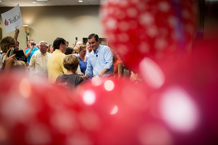 UNITED STATES - AUGUST 9: Presidential candidate Sen. Ted Cruz (R-TX) seen through red balloons, arrives to speak to supporters during the Cruz campaign bus tour rally in Pelham, Ala., on Sunday, Aug. 9, 2015. (Photo By Bill Clark/CQ Roll Call)