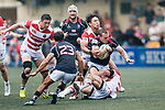 Naoki Ozawa of Japan (B) puts a tackle on Alex McQueen of Hong Kong (U) during the Asia Rugby Championship 2017 match between Hong Kong and Japan on May 13, 2017 in Hong Kong, China. Photo by Marcio Rodrigo Machado / Power Sport Images