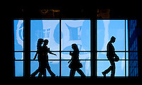 Workers walk on a skywalk between buildings in uptown Charlotte, NC.