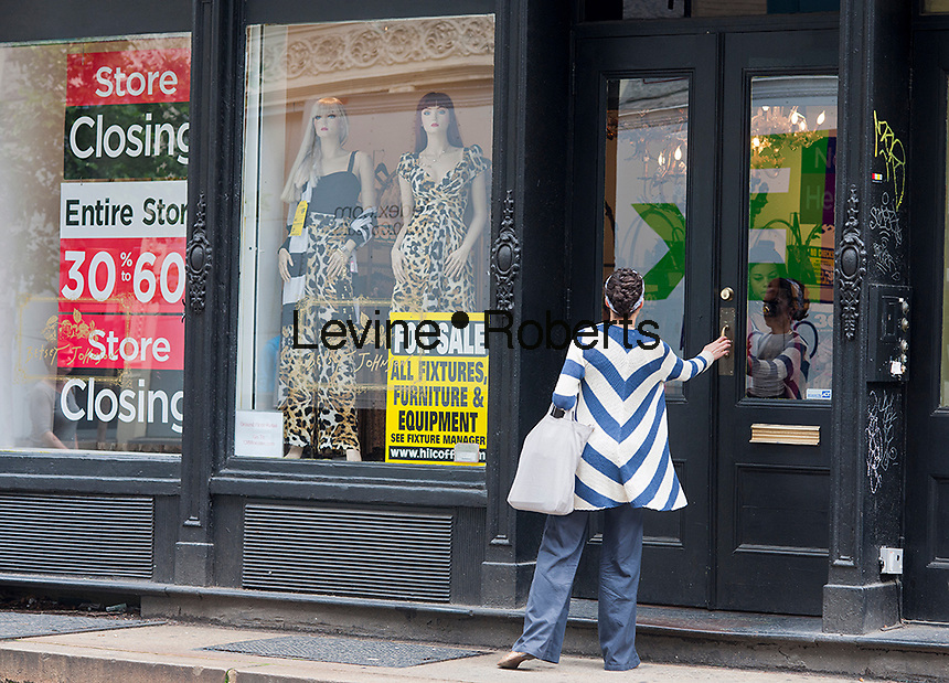 A store closing sale at the Betsy Johnson store on Wooster Street in the New York neighborhood of Soho on Friday, May 25, 2012. Betsey Johnson is closing all of its stores after going into Chapter 11 bankruptcy protection. (© Richard B. Levine)