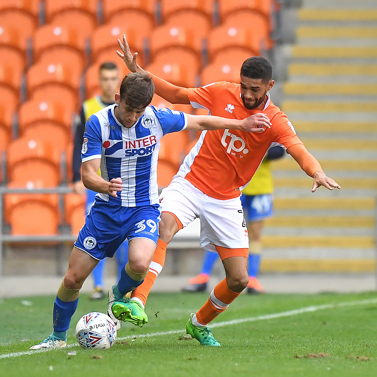Blackpool's Kelvin Mellor battles with Wigan Athletic's Callum Lang<br /> <br /> Photographer Dave Howarth/CameraSport<br /> <br /> The EFL Checkatrade Trophy - Blackpool v Wigan Athletic - Tuesday 29th August 2017 - Bloomfield Road - Blackpool<br />  <br /> World Copyright &copy; 2018 CameraSport. All rights reserved. 43 Linden Ave. Countesthorpe. Leicester. England. LE8 5PG - Tel: +44 (0) 116 277 4147 - admin@camerasport.com - www.camerasport.com
