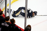 Adam Clendening #2 of the Pittsburgh Penguins lays on the ice after getting hit against the corner boards in the first period against the Colorado Avalanche during the game at Consol Energy Center on November 19, 2015. (Photo by Jared Wickerham/DKPittsburghSports)