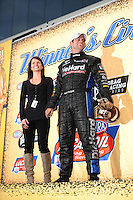 Sept. 18, 2011; Concord, NC, USA: NHRA funny car driver Matt Hagan celebrates with wife Rachel Hagan after winning the O'Reilly Auto Parts Nationals at zMax Dragway. Mandatory Credit: Mark J. Rebilas-