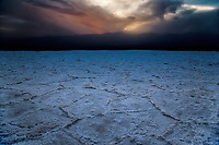 The salt flats at sunset at Badwater Basin at Death Valley National Park, California
