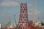 Construction of the ArcelorMittal Orbit, on the site of the London 2012 Olympic Park, which was designed by Anish Kapoor and financed by steel magnate Lakshmi Mittal.  The sculpture. close to the tower blocks of the Olympic Village, will be the largest in the UK.