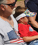 A man and a boy watching the Saugerties July 4th Parade on Main Street in Saugerties, NY on Monday, July 4, 2011. Photo by Jim Peppler. Copyright © Jim Peppler 2011.