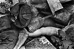 Found broken doll body parts, in slum clearance housing Kilburn north London 1967.