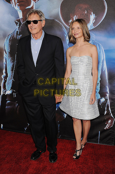 "Harrison Ford and Calista Flockhart.The world premiere of ""Cowboys & Aliens"" at the San Diego Civic Theatre in San Diego, California, USA..July 23rd, 2011.full length silver grey gray white black polka do dress strapless couple black blue sunglasses shades .CAP/ROT/TM.©Tony Michaels/Roth Stock/Capital Pictures"