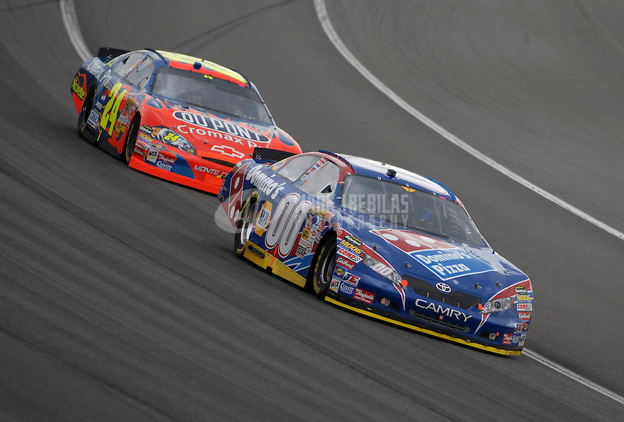 Feb 25, 2007; Fontana, CA, USA; Nascar Nextel Cup Series driver David Reutimann (00) leads Jeff Gordon (24) during the Auto Club 500 at California Speedway. Mandatory Credit: Mark J. Rebilas