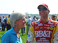 Sept. 27, 2008; Kansas City, KS, USA; NASCAR Nationwide Series driver Clint Bowyer (right) talks with Kansas governor Kathleen Sebelius prior to the Kansas Lottery 300 at Kansas Speedway. Mandatory Credit: Mark J. Rebilas-