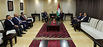 Palestinian Prime Minister Rami Hamdallah meets with Jordanian Minister of Works and Housing Yahya Kasbi and Palestinian Minister of public works and housing, Mofeed al-Hasayna in the West Bank city of Ramallah on September 18, 2018. Photo by Prime Minister Office