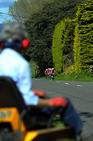 A lawn mower watches Scots College A u20 boys during the 2017 NZ Schools Road Cycling championships day one team time trials at Koputaroa Road near Levin, New Zealand on Saturday, 30 September 2017. Photo: Dave Lintott / lintottphoto.co.nz