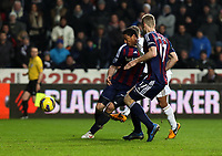 Saturday 19 January 2013<br /> Pictured: Jonathan de Guzman of Swansea (C) scoring his second goal, Robert Huth (L) and Ryan Shawcross (R) of Stoke were unable to stop him.<br /> Re: Barclay's Premier League, Swansea City FC v Stoke City at the Liberty Stadium, south Wales.
