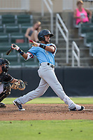 Miguel Aparicio (5) of the Hickory Crawdads follows through on his swing against the Kannapolis Intimidators in game one of a double-header at Kannapolis Intimidators Stadium on May 19, 2017 in Kannapolis, North Carolina.  The Crawdads defeated the Intimidators 5-4.  (Brian Westerholt/Four Seam Images)