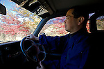 A priest of the Jodo Shinshu sect of Buddhism, drives his Big Horn 4WD through a section of Aokigahara Jukai, better known as the Mt. Fuji suicide forest, in Yamanashi Prefecture, west of Tokyo, Japan on 04 Nov. 2009. ..