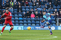 Scott Kashket of Wycombe Wanderers shoots during the Sky Bet League 2 match between Wycombe Wanderers and Leyton Orient at Adams Park, High Wycombe, England on 17 December 2016. Photo by David Horn / PRiME Media Images.