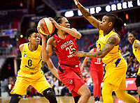 Washington, DC - June 15, 2018: Washington Mystics forward Monique Currie (25) guarded by Los Angeles Sparks guard Riquna Williams (2) and Alana Beard (0) during game between the Washington Mystics and Los Angeles Sparks at the Capital One Arena in Washington, DC. (Photo by Phil Peters/Media Images International)
