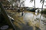 A Cyclone Nargis survivor walks in the village of Kamingo, at the Irrawaddy Division, May 10, 2008. Despairing survivors in Myanmar awaited emergency relief on Friday, a week after 100,000 people were feared killed as the cyclone roared across the farms and villages of the low-lying Irrawaddy delta region. The storm is the most devastating one to hit Asia since 1991, when 143,000 people were killed in neighboring Bangladesh. Photo by Eyal Warshavsky  *** Local Caption *** ëì äæëåéåú ùîåøåú ìàéì åøùáñ÷é àéï ìòùåú áúîåðåú ùéîåù ììà àéùåø