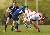 Saturday 12th May 2012  Ulster flanker Andrew Kelly is collared by Leinster out half Paddy Behan during the Junior Inter-Provincial between Ulster and Leinster at the Glynn, Larne, County Antrim.<br /> <br /> Photo credit : John Dickson / DICKSONDIGITAL