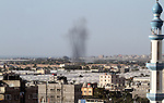 Smoke rises following an Israeli air strike in Rafah, in the southern Gaza Strip, on May 5, 2016. Israeli warplanes struck four new Hamas positions in the southern Gaza Strip, as a flare-up continued to threaten a 2014 ceasefire agreement. Photo by Abed Rahim Khatib