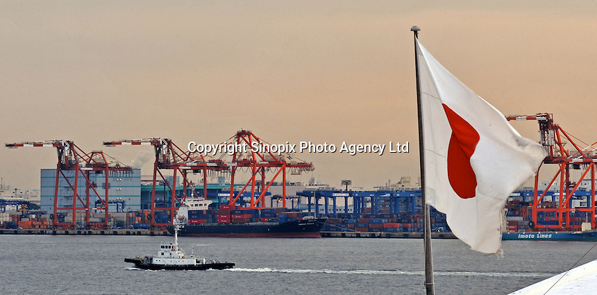 A ship passes the Port of Tokyo, Japan with a the national flag in front. Industrial production in Japan plunged at the steepest pace in 55 years in the fourth quarter, and unemployment rose at the fastest rate in 41 years with exports in the third quarter were a record 13.9 per cent lower than in the previous quarter..19 Feb 2009