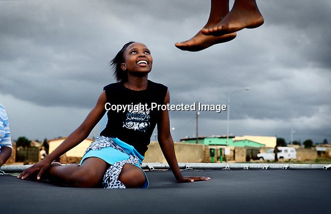 Children play on a trampoline in Soweto, Johannesburg, South Africa. Soweto is the biggest township in South Africa, and has a population of about 3.5 million. (Photo by: Per-Anders Pettersson)