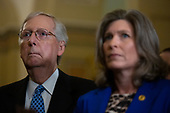 United States Senate Majority Leader Mitch McConnell (Republican of Kentucky) and United States Senator Joni Ernst (Republican of Iowa) listen during the Senate Policy Luncheon Press Conference on Capitol Hill in Washington D.C., U.S. on October 22, 2019.<br /> <br /> Credit: Stefani Reynolds / CNP