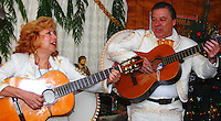 Titina and Raul Vazquez play at Las Posadas Saturday night, December 22, in Madison. Las Posadas is a nine-day traditional celebration for Latin Americans, culminating on Christmas Eve.