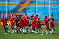The United States Men's National jogs on the pitch of Estadio Mateo Flores in Guatemala City, Guatemala on Mon. June 11, 2012 during practice.  The USA will face Guatemala in a World Cup Qualifier on Tuesday.